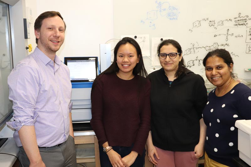 Dr Muth and some students in his team at St John's University